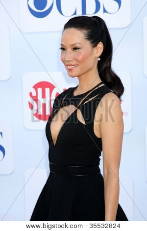 LOS ANGELES - JUL 29:  Lucy Liu arrives at the CBS, CW, and Showtime 2012 Summer TCA party at Beverly Hilton Hotel Adjacent Parking Lot on July 29, 2012 in Beverly Hills, CA