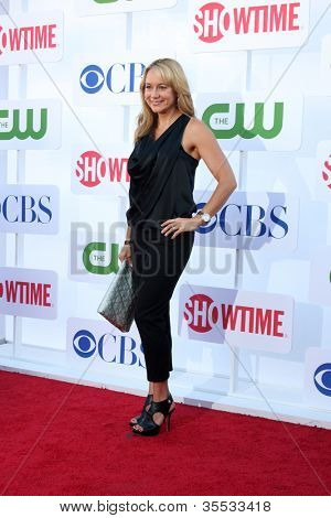 LOS ANGELES - JUL 29:  Megyn Price arrives at the CBS, CW, and Showtime 2012 Summer TCA party at Beverly Hilton Hotel Adjacent Parking Lot on July 29, 2012 in Beverly Hills, CA