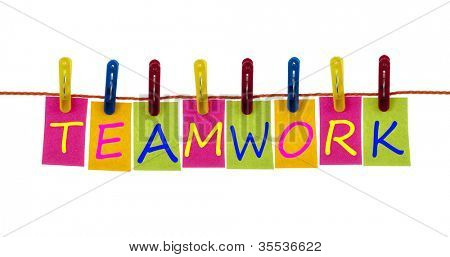 Teamwork word on laundry hook on white