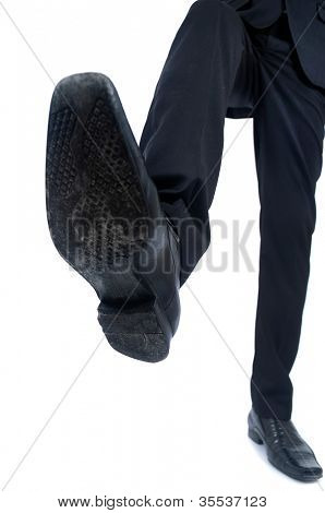 Business man foot trample closeup