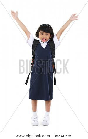 Six years old Southeast Asian school girl arms up in the air, fullbody over white background
