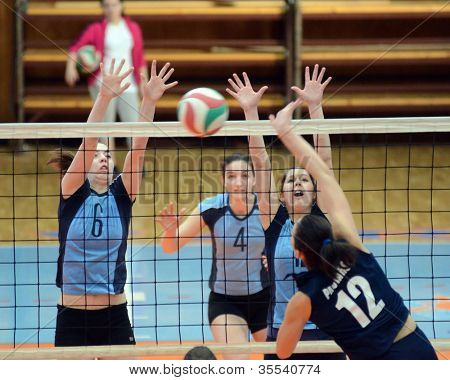 KAPOSVAR, HUNGARY - MARCH 16:Kamilla Gyorbiro (6) in action at the Hungarian Championship volleyball game Kaposvar (blue) vs Palota (deep blue), March 16, 2012 in Kaposvar, Hungary