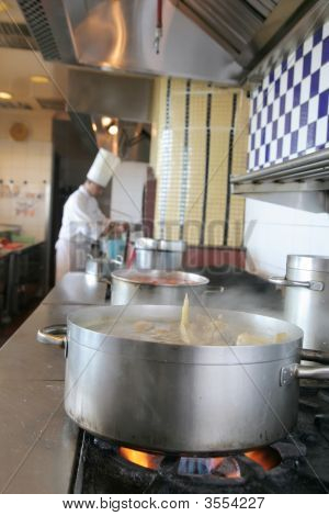 Cooking At Restaurant Kitchen