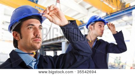 Two engineers at work in a factory