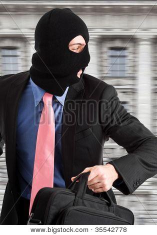 Portrait of a burglar running with a handbag