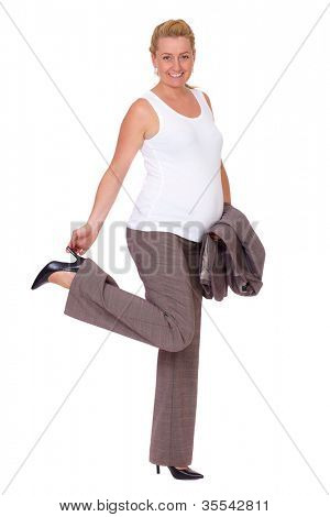 Attractive pregnant businesswoman over white background