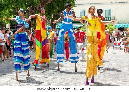 HAVANA-JULY 20:Unidentified street dancers July 20,2012 in Havana.With Cuba receiving over two million tourists a year,artists representing the cuban culture are part of the atmosphere of Old Havana
