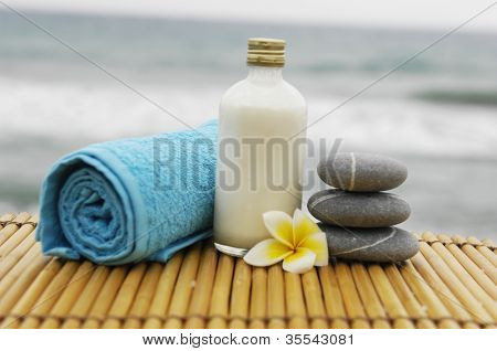 Zen concept �¢�?�?blue towel and salt in a glass with frangipani flower on mat