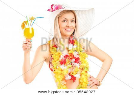 Portrait of a female dressed in a hawaiian costume holding an orange cocktail isolated on white