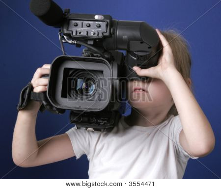 Little Girl And Big Camera