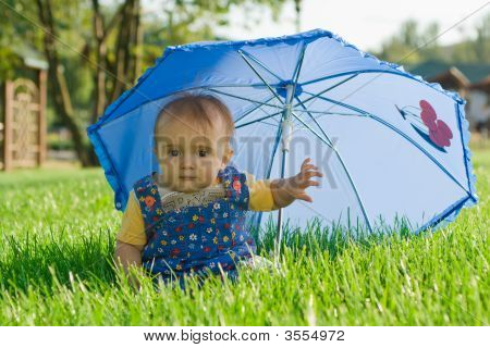 Baby Sitting Under Umbrella