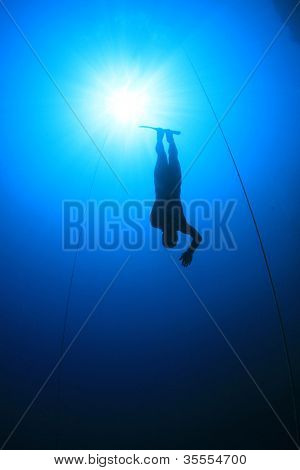 Freediver dives into deep blue ocean