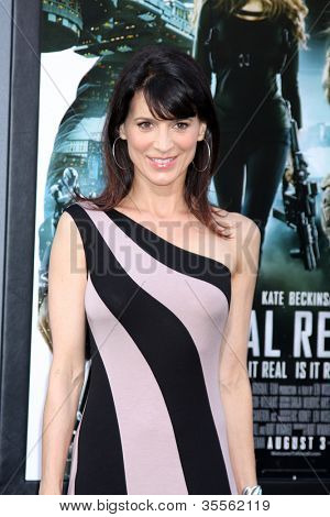 """LOS ANGELES - AUG 1:  Perrey Reeves arrives at the """"Total Recall"""" Premiere at Graumans Chinese Theater on August 1, 2012 in Los Angeles, CA"""