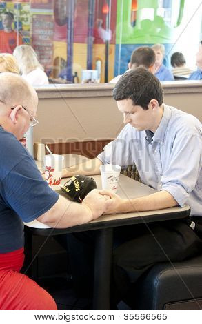 PENSACOLA, FL - AUGUST 1, 2012: Patrons pray at Chick-Fil-A restaurant in Pensacola, FL, on August 1, 2012 on national Day of Support following backlash from the owner supporting traditional marriage.