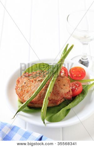 Marinated pork chop accompanied with vegetables