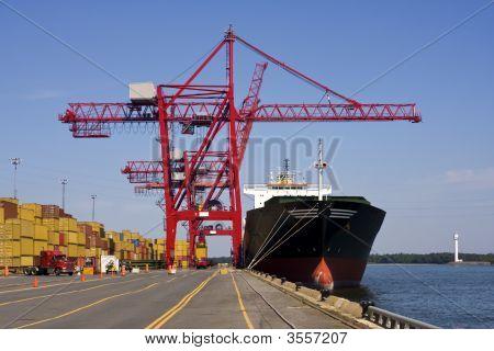Port Container Cranes Unloading A Ship