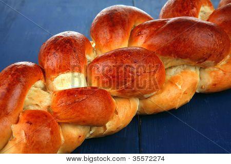 sweet bread : golden challah over blue wooden plate