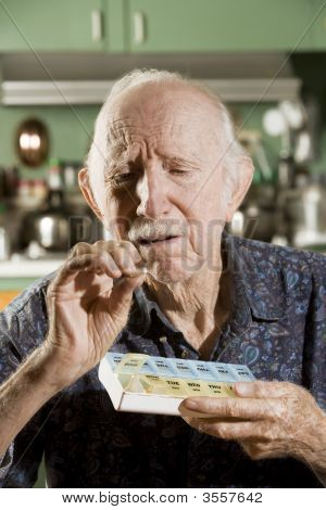 Elder Man With A Pill Case