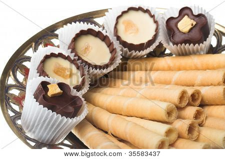 Striped wafer tubules with a chocolate cream and chokolate sweets.