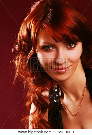 Portrait of a beautiful, sexy red hair girl