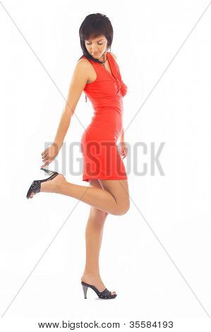 classical pin-up image of lovely brunette in red dress over white