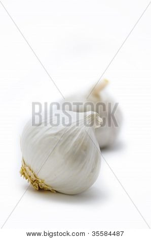 Two Pieces Of Garlic On A White Background