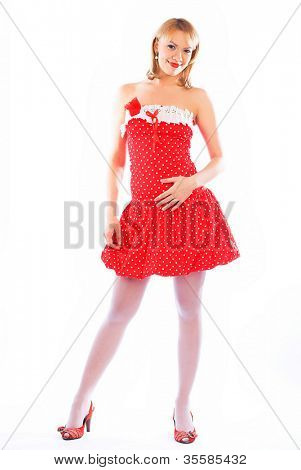 pin-up image of lovely blond in red dress over white