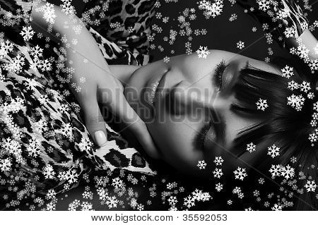 christmas picture of beautiful girl with snowflakes. Monocrome picture.