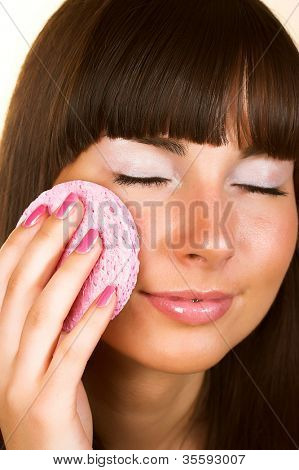 Sweet skincare. Attractive girl applying face pack.