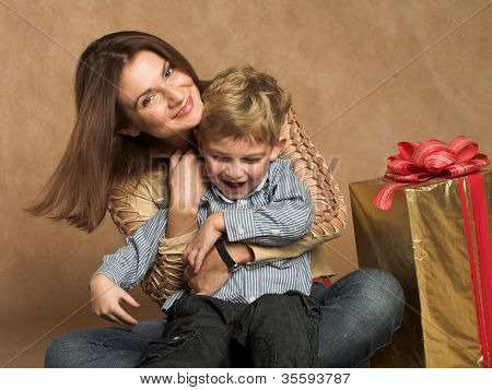 Woman and boy checking christmas presents