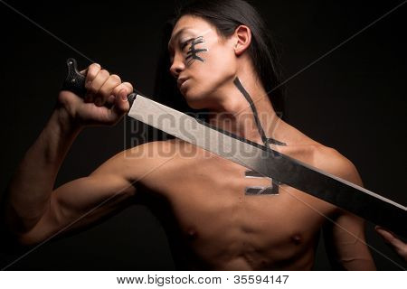 asian boy with weapons