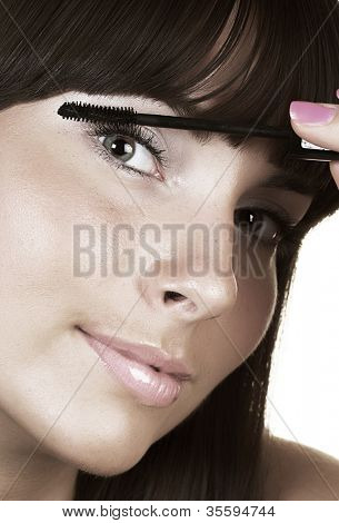Portrait of Beautiful brunette woman doing daily morning routines (the make up series)