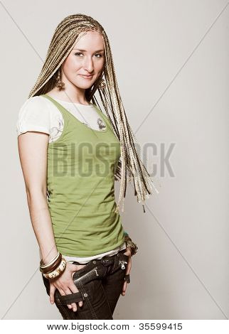 Studio portrait of a young beautiful girl with dreadlocks