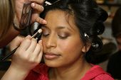 stock photo of makeup artist  - Having makeup applied by make up artist for photograph session - JPG