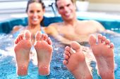 picture of wet feet  - Young relaxed couple in jacuzzi - JPG