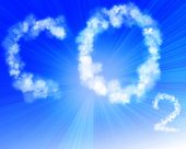 picture of carbon-dioxide  - co2 written in the clouds in a clear blue sky - JPG