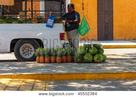 Selling Watermelon And Papaya On The Streets Of Yucatan