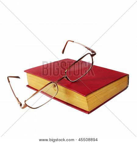 glasses and a red book isolated on white background