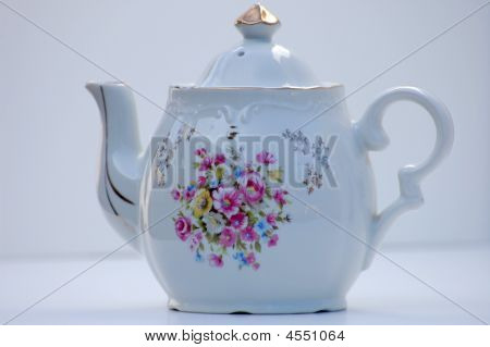 Antique White Teapot With Gold Top White Background