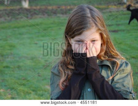 Young Girl Cupping Face With Hands