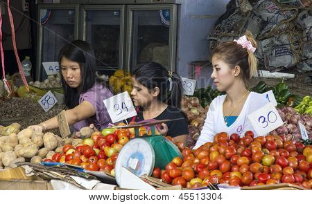 Bangkok, Thailand Sep 27Th: Customers At A Vegetable Stall  In Khlong Toei Market On September 27Th