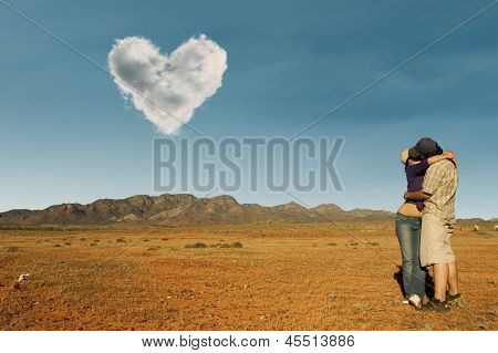 Couple Kissing At Australian Desert Under Love Cloud