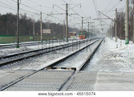 Railway in snow and electric train