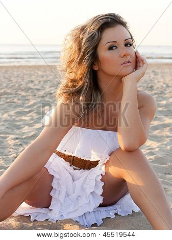 Beautiful Woman In White Dress At The Beach