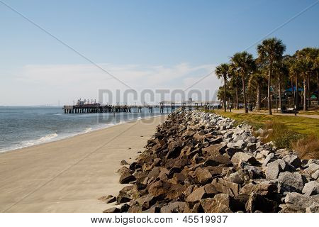 Stone Seawall Toward Empty Pier