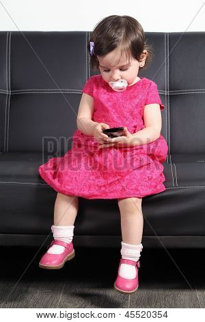 Beautiful Baby Playing With A Smart Phone At Home