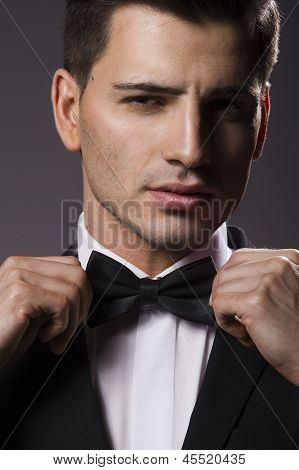 Close-up Portrait Of A Young Handsome Man With Bow Tie
