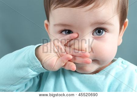 Close Up Of A Baby Girl Looking At Camera With A Big Blue Eyes