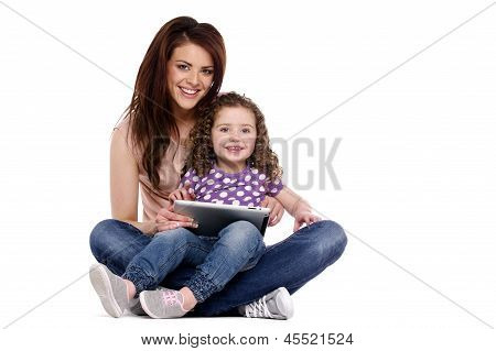 Mother And Daughter Using A Computer Tablet