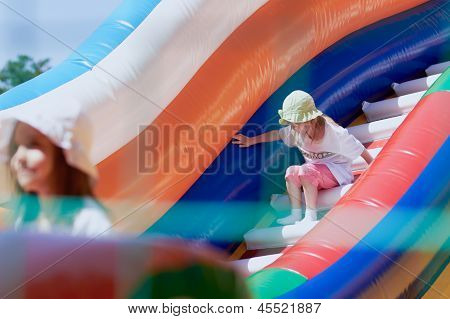 Little Girls In A Jumping Castle